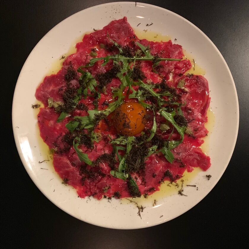 Wagyu-carpaccio-cured-yolk-parmesan-cream-rocket-truffle